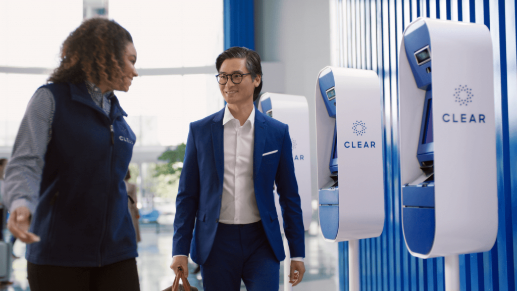 CLEAR Ambassador and traveler at the CLEAR pods.